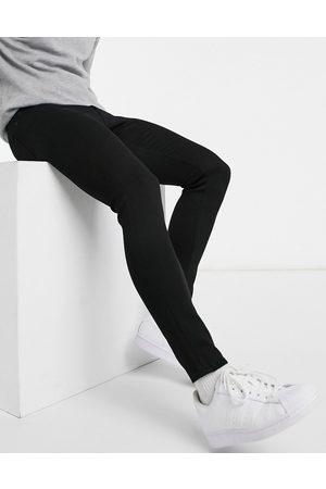 ASOS Spray on jeans in power stretch denim in black