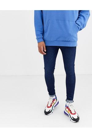 ASOS Spray on jeans in power stretch denim in dark wash blue