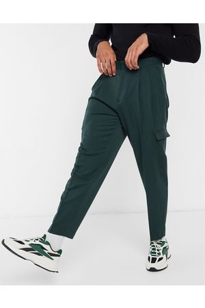 ASOS Oversized tapered smart trousers in dark green with cargo pockets