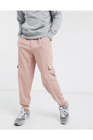 ASOS Oversized tapered smart jogger trousers in pink with cargo pocket