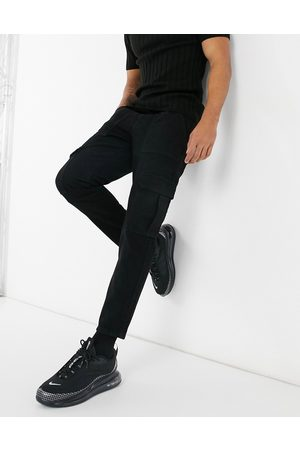 ASOS Classic rigid jeans with cargo pocket in black
