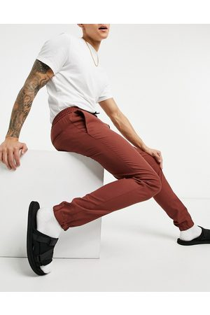 ASOS Skinny smart jogger in rust-Tan