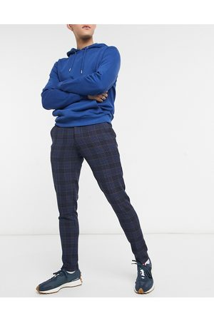 ASOS Super skinny suit trousers in birdseye check in navy