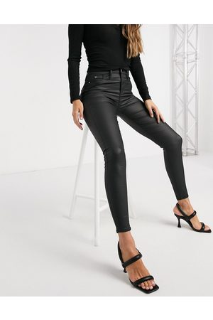 River Island Molly waxed coated skinny jeans in black