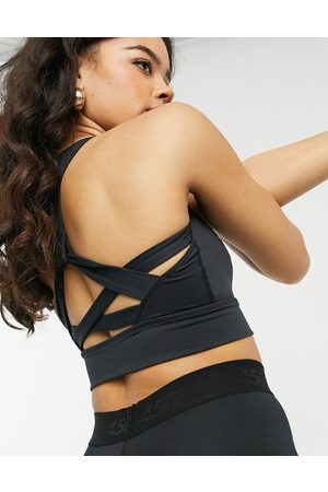 Free People Light synergy sports bra with cut out back co-ord-Black