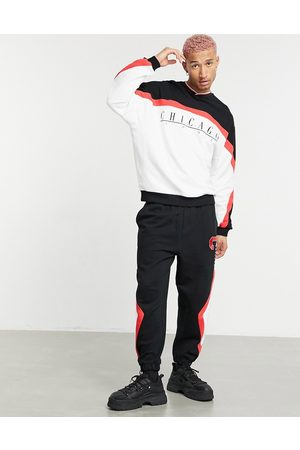 ASOS DESIGN Co-ord oversized joggers with colour block Chicago print in vintage wash-Black