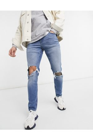 New Look Skinny jeans with knee rips in mid blue