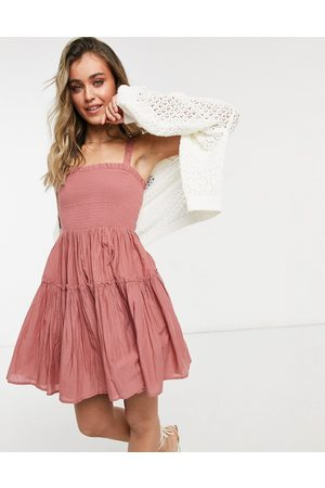 ASOS DESIGN Cami mini sundress with raw edges in dusky pink
