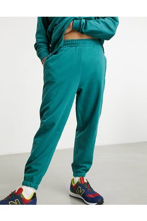 ASOS DESIGN Muži Tepláky - Co-ord oversized joggers in green