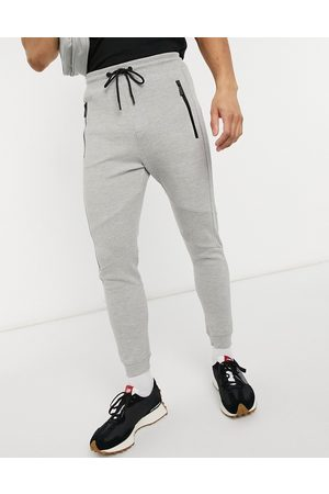 Bershka Piping joggers in grey
