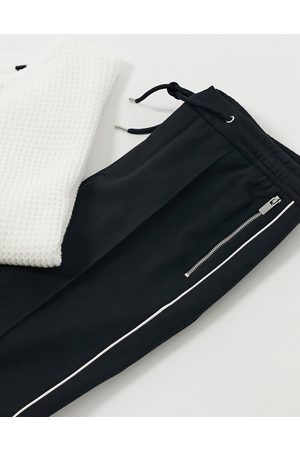 River Island Muži Tepláky - Smart joggers with side stripe in navy