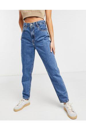 Levis Ženy S vysokým pasem - Levi's high loose tapered jean in midwash blue