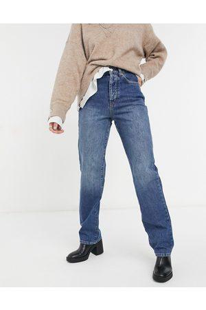 Topshop Carpenter jeans in mid wash blue