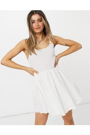 ASOS Shirred mini skater sundress with scoop back in white