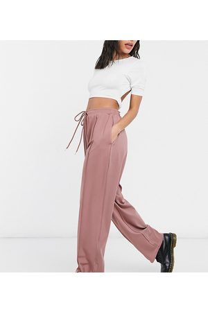 COLLUSION Tepláky - Unisex relaxed joggers in poly tricot in dusty pink co-ord