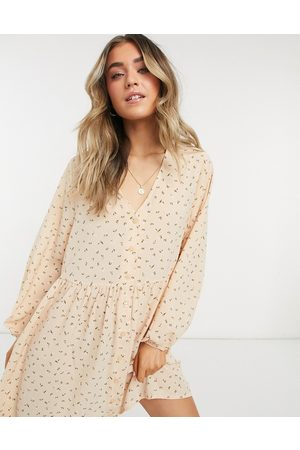 Monki Torborg mini smock dress with button through detail in pink floral print