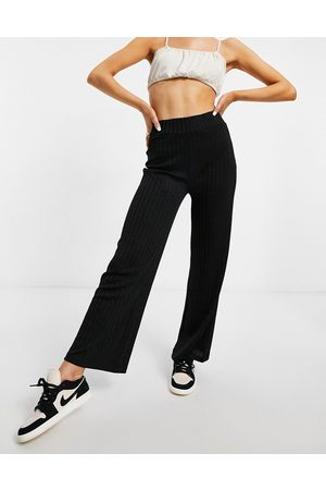 NA-KD Ribbed high waist jersey trousers in black