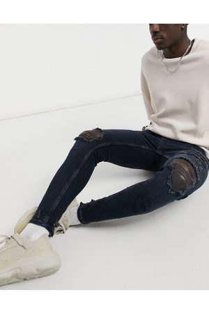 Pull&Bear Muži Skinny - Premium skinny fit jeans in navy blue with rips