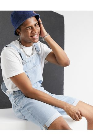 ASOS DESIGN Relaxed denim dungaree shorts in light stone wash blue