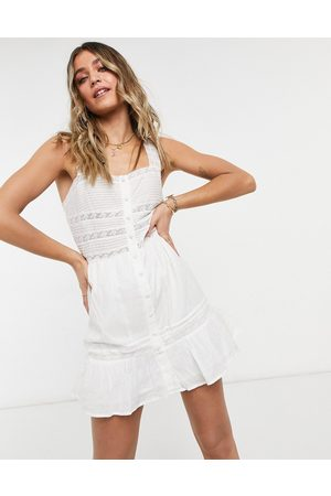 ASOS Ženy Na párty - Button through square neck mini sundress with lace inserts in white