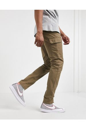 ASOS Muži Kapsáče - Skinny cargo trousers in brown