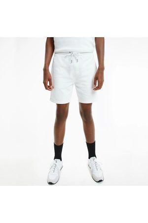 Calvin Klein Muži Šortky - Pánské bílé šortky