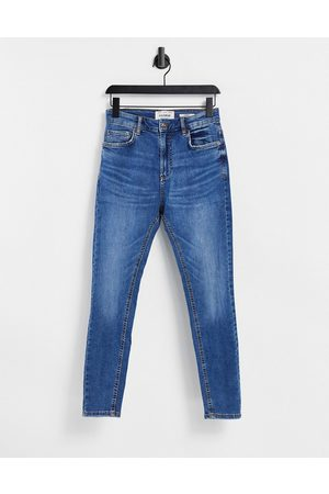 Pull&Bear Carrot jeans in mid wash blue