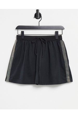 Parisian Ženy Teplakovka - Jogger shorts with diamonte stripe in black
