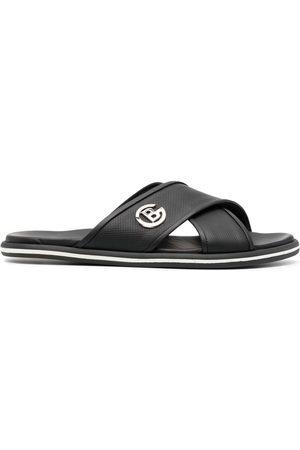 BALDININI Logo-plaque crossover strap sandals