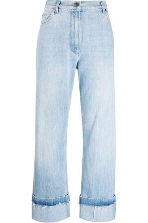 Gucci Turn-up hem light wash jeans
