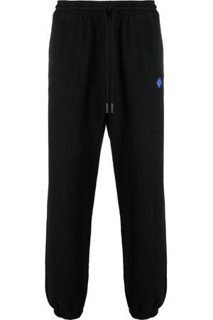 MARCELO BURLON Muži Tepláky - Geometric-pattern track pants