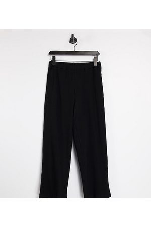 COLLUSION Tepláky - Unisex relaxed joggers in heavy rib in black co-ord