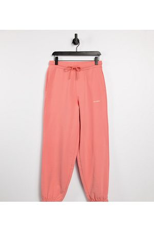 COLLUSION Unisex oversized joggers in pink co-ord