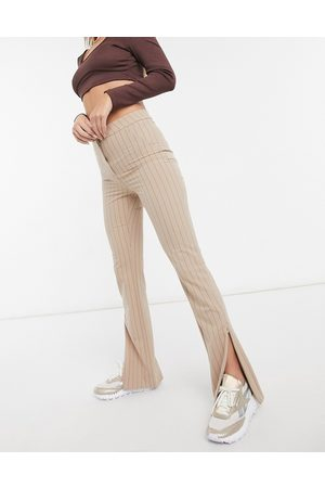 Weekday Ženy Legíny - Alecia stright leg trousers with split front in beige pinstripe