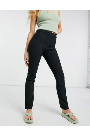 Weekday Alecia straight leg trousers with zip hem in black