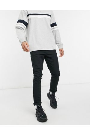 ASOS Muži Chino - Skinny chinos in black