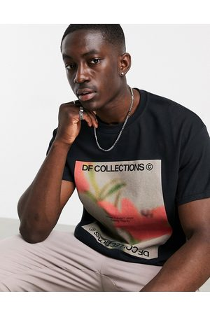 ASOS Relaxed t-shirt in black with floral print and logo