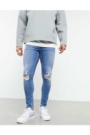 ASOS Muži Skinny - Spray on jeans with power stretch in vintage mid wash blue with knee rips