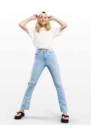 ASOS High rise '70s' stretch flare in pretty lightwash with knee rip-Black