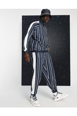 ASOS Muži Tepláky - Co-ord oversized joggers in pin stripe with side panel in black & white