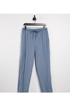 COLLUSION Unisex slim tapered joggers in poly tricot in dusty blue co-ord