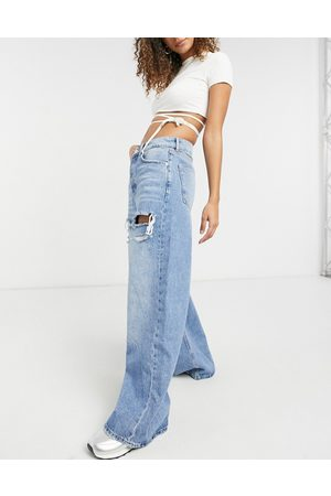 Bershka 90s baggy jeans with thigh rip in light blue wash