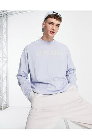 ASOS Oversized long sleeve t-shirt in blue with front text wellness print