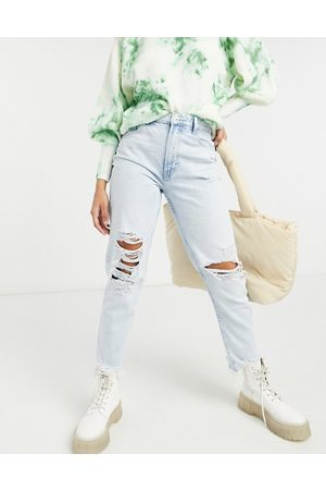 Bershka Organic cotton mom jean with distressed hem in light blue