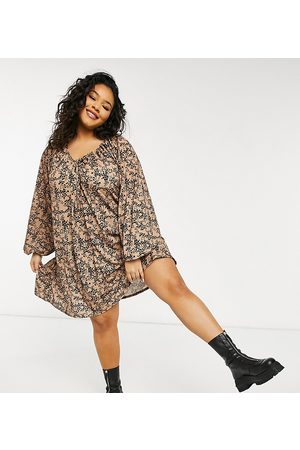 ASOS ASOS DESIGN Curve mini smock dress with long sleeves and tie neck detail in animal print-Black