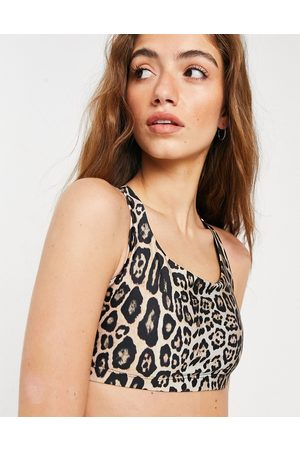 Onzie Chic medium support yoga sports bra in leopard-Multi