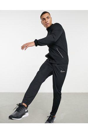 Nike Football Muži Teplakovka - Academy tracksuit in black and white