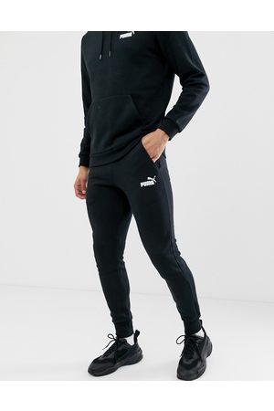 PUMA Muži Tepláky - Essentials small logo slim joggers in black