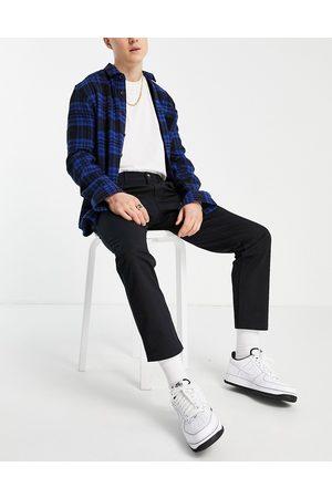 New Look Muži Chino - Slim chino trousers in black