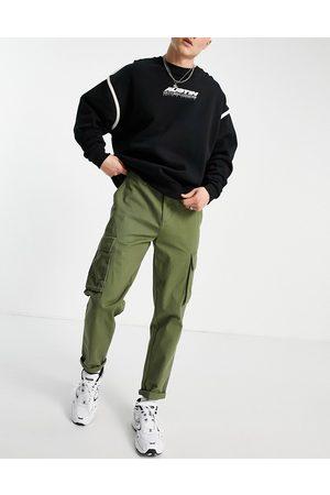 New Look Muži Kapsáče - Cargo trouser in khaki-Green